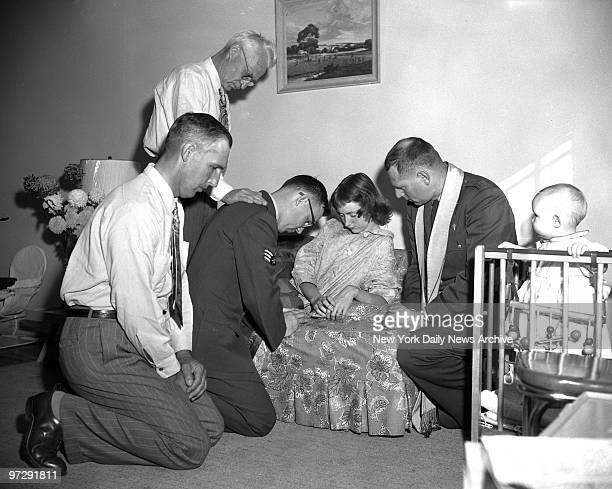 Sgt Jerry Damman and his wife Marilyn pray with friends after the kidnapping of their son Steven