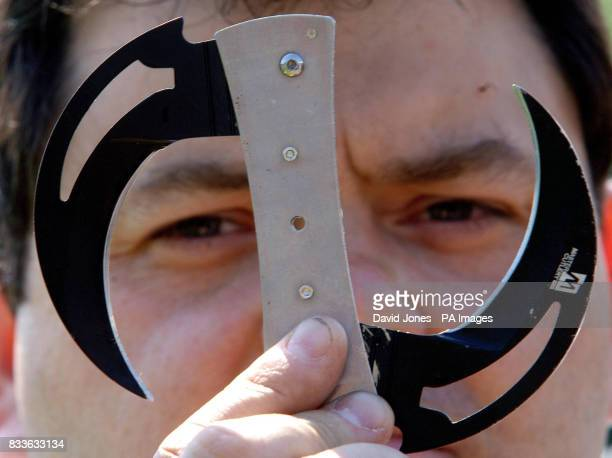 Sgt Jim Mills of Staffordshire Police looks through a collapsible circular throwing knife handed in during the current knife amnesty PRESS...