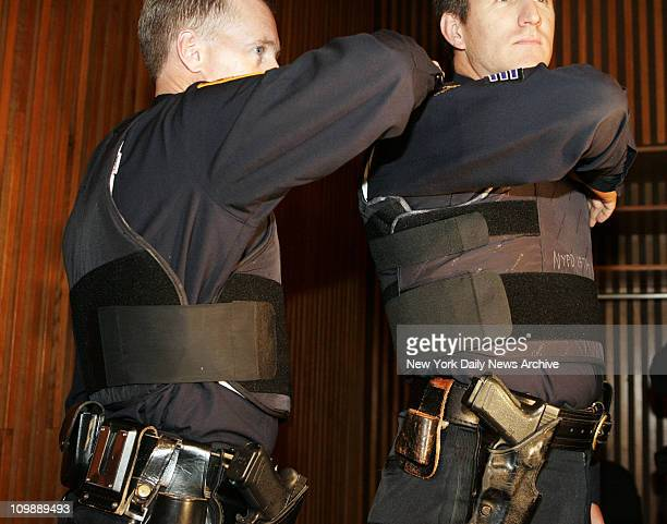 Sgt John Kirrane right models the new NYPD vest with added protection on the sides with overlapping kevlar as opposed to the less protection offered...