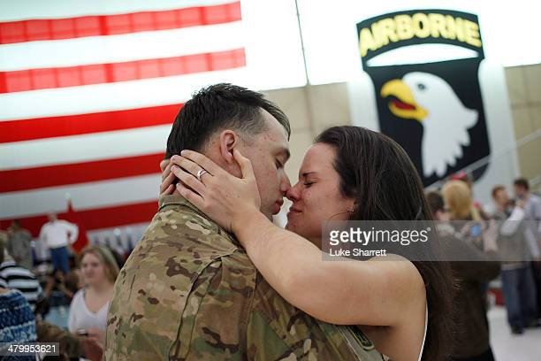Sgt. Johnathan Link of the U.S. Army's Battery B, 2nd Battalion, 44th Air Defense Artillery Regiment, 101st Airborne Division, embraces his...