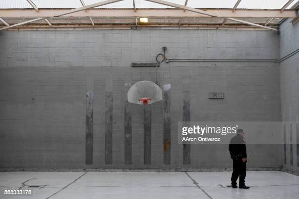 Sgt Jonathan Zamora walks through the basketball court at the Pueblo County Detention Center on Wednesday December 6 2017 The jail which is currently...