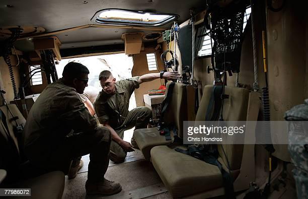Sgt Joseph Thacker of TUS con Arizona shows Spc Jose Estrada of Traverse City Michigan details of a new MRAP vehicle November 19 2007 at Forward...