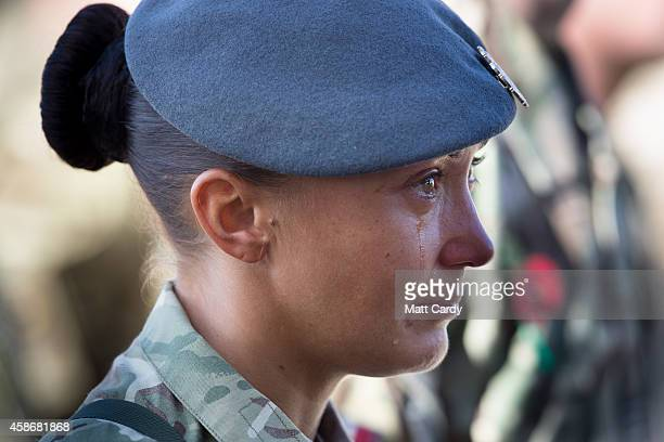 Sgt Khym France reacts as she attends a Remembrance Sunday service for British troops and service personal still remaining in Afghanistan at Kandahar...