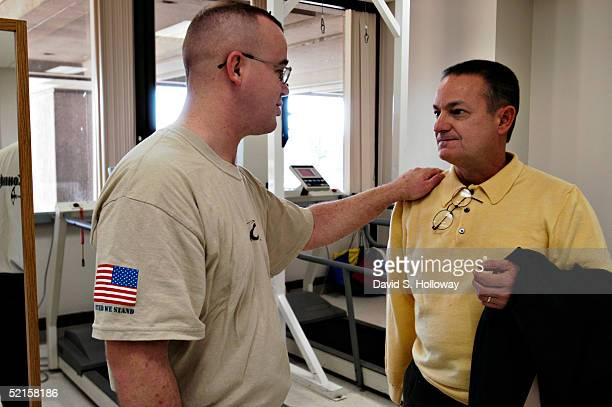 Sgt Luke Cassidy of Fairfax VA speaks with DAV member Paul Bernacchio and thanks him for all of the fighting that former amputees did to make sure...