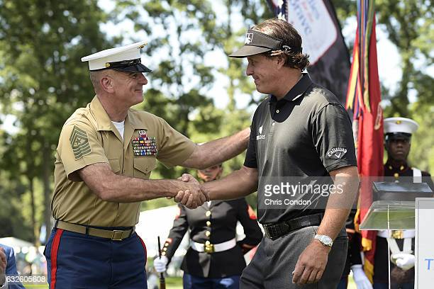 Sgt Major Bryan Battaglia presents Phil Mickelson with two sets of dog tags during the military appreciation ceremony at The Barclays at Ridgewood...