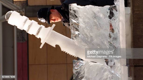 Sgt Nigel South of Peckham Police casts his eye over an ice sculpture of a knife as Southwark Council and the Metropolitan police launched antiknife...