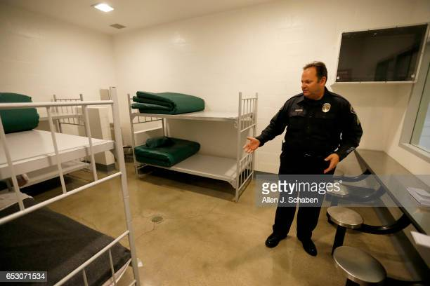 Sgt Steven Bowles gives a tour of a jail dorm where paytostay program inmates can watch television at the Seal Beach Detention center in Seal Beach...