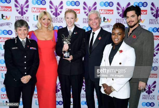 Sgt Stevie Bull with her Good Morning Britain Emergency Services award poses with Cressida Dick Holly Willoughby Phillip Schofield Nicola Adams and...