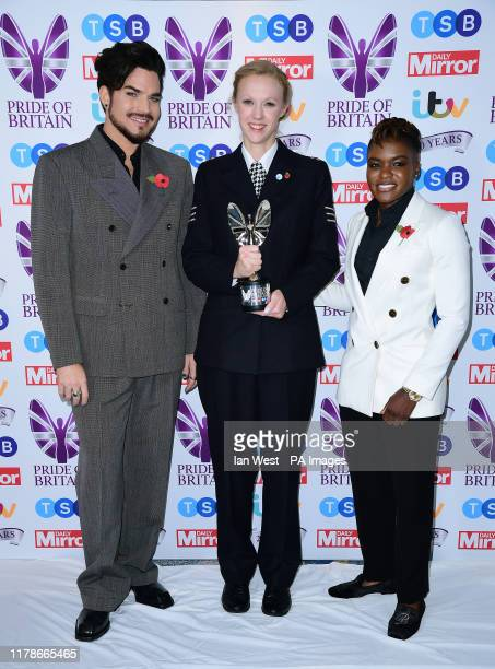 Sgt Stevie Bull with her Good Morning Britain Emergency Services award poses with Nicola Adams and Adam Lambert during the Pride of Britain Awards...