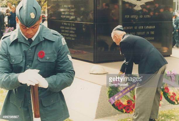Sgt Vincent Dos Santos of the Cadet League of Canada stands on guard while veteran Dan Dillon honours Canadians who fought and died in war by laying...