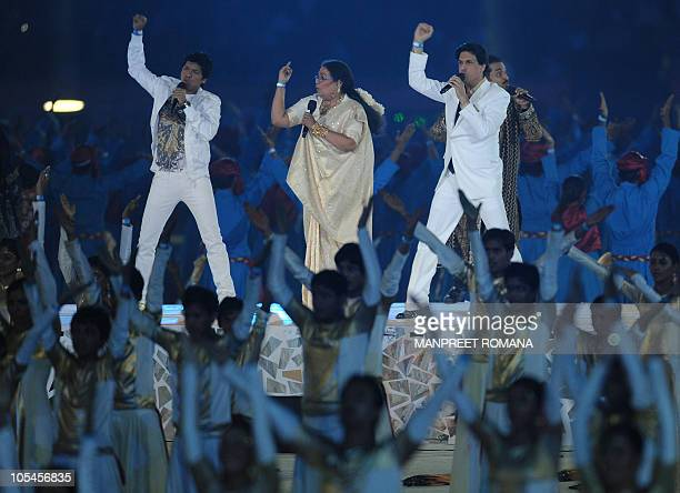 Shaan Usha Uthup and Shiamak Davar perform during the closing ceremony of the XIX Commonwealth Games at Jawarharlal Nehru Stadium in New Delhi on...