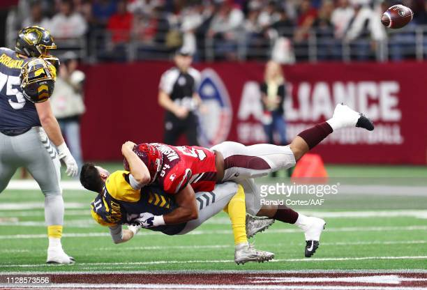 Shaan Washington of the San Antonio Commanders sacks Mike Bercovici of the San Diego Fleet during the first quarter in an Alliance of American...