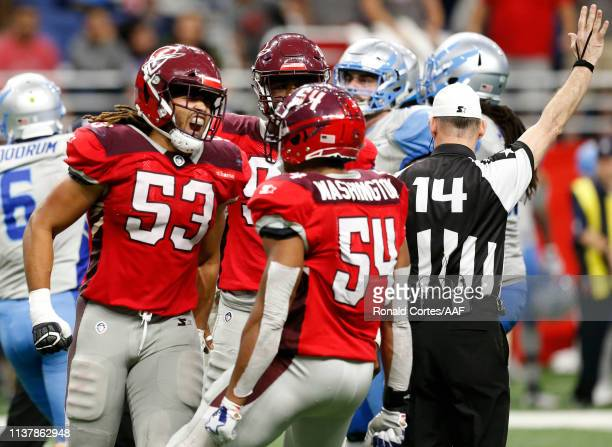 Shaan Washington Ra'Zahn Howard and Austin Larkin of San Antonio Commanders celebrate after Larkin sacked Josh Woodrum of Salt Lake Stallions during...