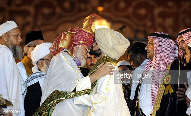 Shaban Ahmed Bukhari kisses the forehead of his father Syed Ahmed Bukhari Shahi Imam of Delhis Jama Masjid after his father anointed him as his...