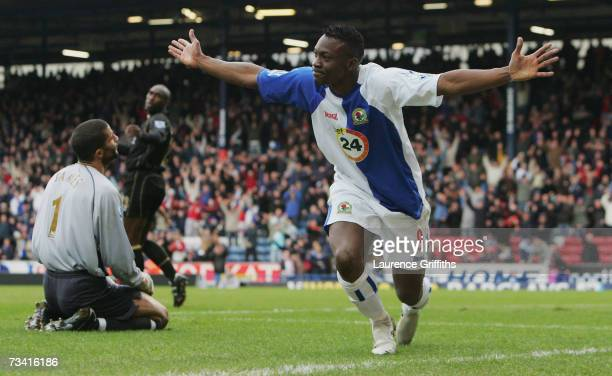 Shabani Nonda of Blackburn Rovers celebrates scoring the opening goal past David James of Portsmouth during the Barclays Premiership match between...