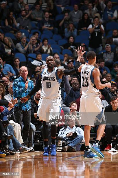 Shabazz Muhammad and Kevin Martin of the Minnesota Timberwolves celebrates against the Memphis Grizzlies during the game on January 23 2016 at Target...