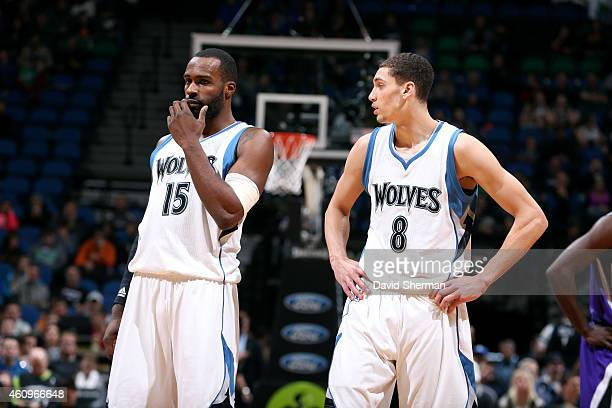 Shabazz Muhammad and Zach LaVine of the Minnesota Timberwolves speak during a game against the Sacramento Kings on January 1 2015 at Target Center in...