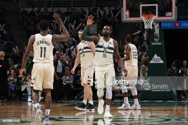 Shabazz Muhammad of the Milwaukee Bucks and Brandon Jennings of the Milwaukee Bucks high five during the game against the Orlando Magic on April 9...