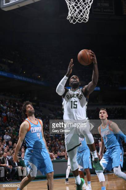 Shabazz Muhammad of the Milwaukee Bucks shoots against Milos Teodosic and Sam Dekker of the Los Angeles Clippers during the NBA game on March 21 2018...