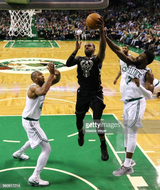 Shabazz Muhammad of the Milwaukee Bucks takes a shot against Jaylen Brown of the Boston Celtics and Al Horford during Game Five in Round One of the...