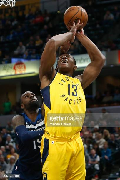 Shabazz Muhammad of the Minnesota Timberwolves blocks a shot by Ike Anigbogu of the Indiana Pacers during the second half at Bankers Life Fieldhouse...