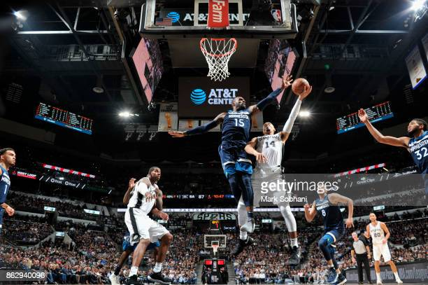 Shabazz Muhammad of the Minnesota Timberwolves blocks the shot of Danny Green of the San Antonio Spurs on October 18 2017 at the ATT Center in San...