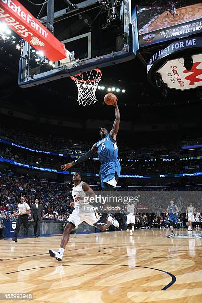 Shabazz Muhammad of the Minnesota Timberwolves goes up for dunk against the New Orleans Pelicans on November 14 2014 at the Smoothie King Center in...