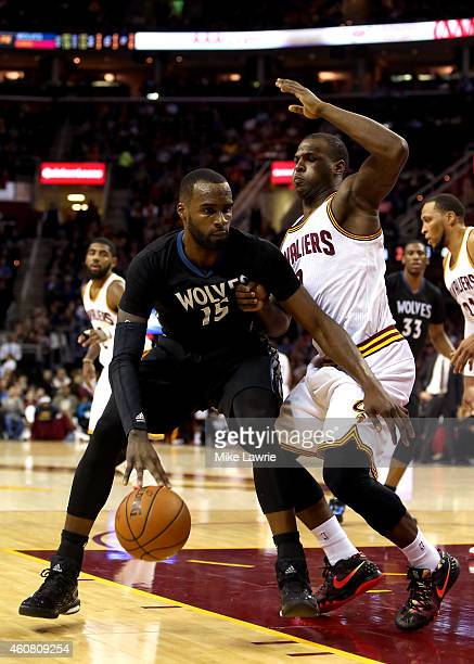 Shabazz Muhammad of the Minnesota Timberwolves handles the ball against Dion Waiters of the Cleveland Cavaliers in the first half at Quicken Loans...