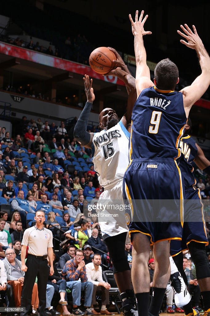 Shabazz Muhammad #15 of the Minnesota Timberwolves shoots against Damjan Rudez #9 of the Indiana Pacers on October 21, 2014 at Target Center in Minneapolis, Minnesota.