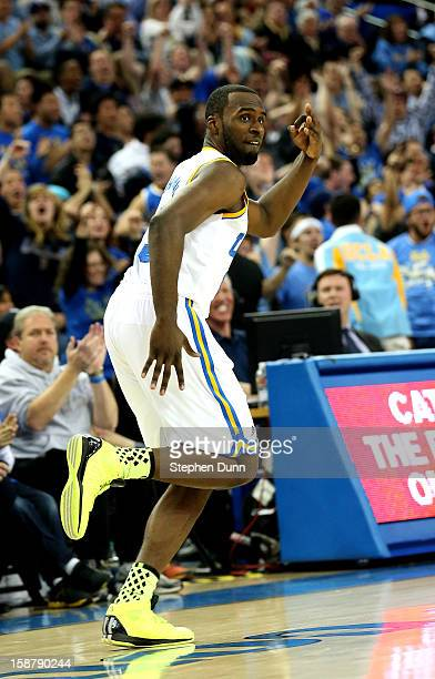 Shabazz Muhammad of the UCLA Bruins celebrates after making a three point basket in overtime against the Missouri Tigers at Pauley Pavilion on...