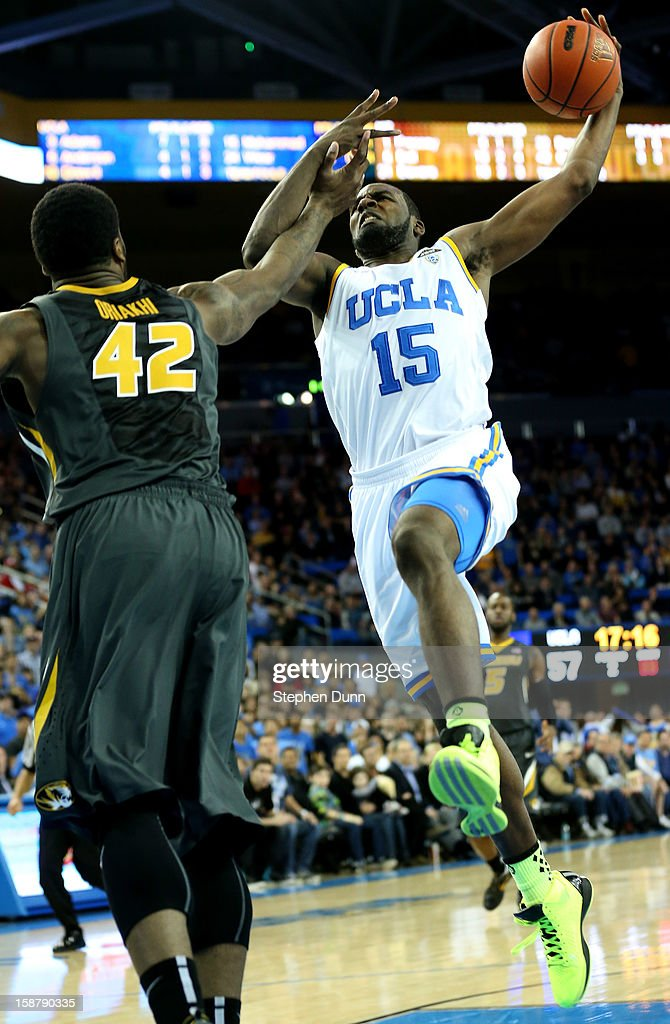 Shabazz Muhammad of the UCLA Bruins goes up for a shot over Alex Oriakhi #42 of the Missouri Tigers at Pauley Pavilion on December 28, 2012 in Los Angeles, California. UCLA won 97-94 in overtime.