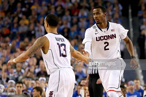 Shabazz Napier and DeAndre Daniels of the Connecticut Huskies celebrate against the Kentucky Wildcats during the NCAA Men's Final Four Championship...