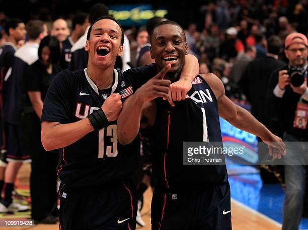 Shabazz Napier and Kemba Walker of the Connecticut Huskies celebrate after defeating the Pittsburgh Panthers during the quarterfinals of the 2011 Big...