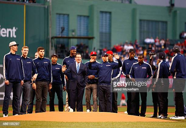 Shabazz Napier and members of the national champion Connecticut Huskies basketball team wait to throw out the first pitch alongside Connecticut...