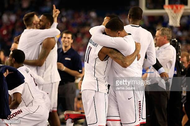 Shabazz Napier and Ryan Boatright of the Connecticut Huskies celebrate after defeating the Kentucky Wildcats 60-54 in the NCAA Men's Final Four...