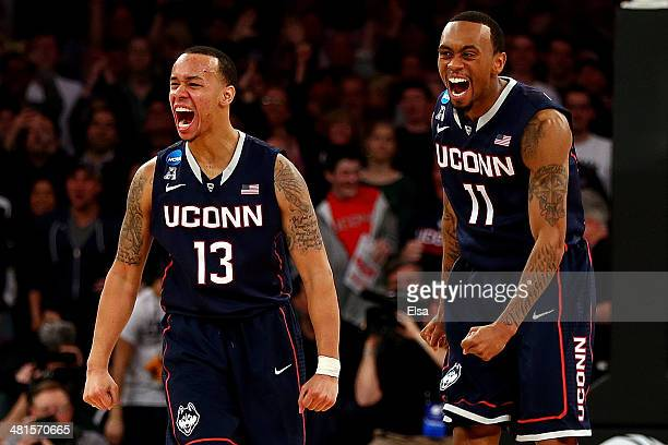 Shabazz Napier and Ryan Boatright of the Connecticut Huskies reacts after a play late in the game against the Michigan State Spartans during the East...