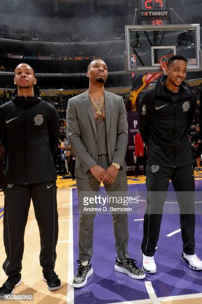 Shabazz Napier Damian Lillard and CJ McCollum of the Portland Trail Blazers stand for the national anthem prior to the game against the Los Angeles...