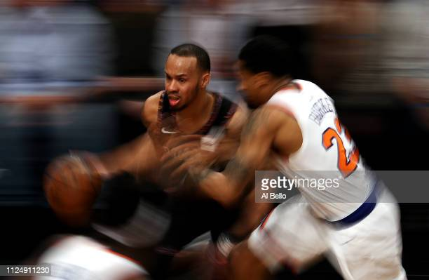 Shabazz Napier of the Brooklyn Nets drives against Trey Burke of the New York Knicks during their game at the Barclays Center on January 25 2019 in...