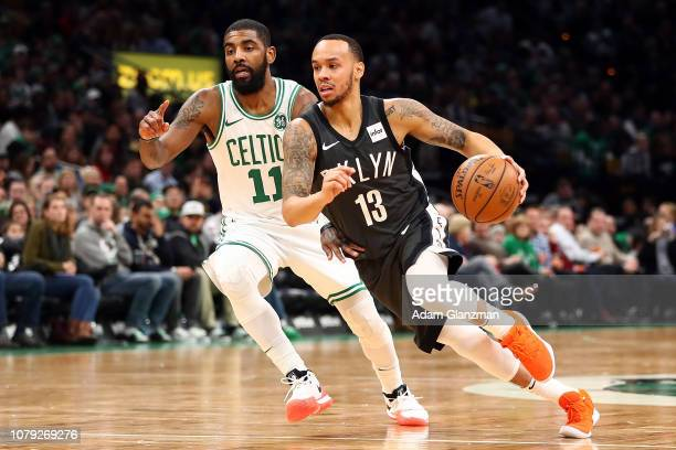 Shabazz Napier of the Brooklyn Nets drives toe the basket past Kyrie Irving of the Boston Celtics during a game at TD Garden on January 7 2019 in...