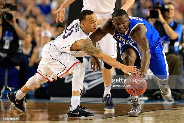 Shabazz Napier of the Connecticut Huskies and Julius Randle of the Kentucky Wildcats battle for a loose ball during the NCAA Men's Final Four...