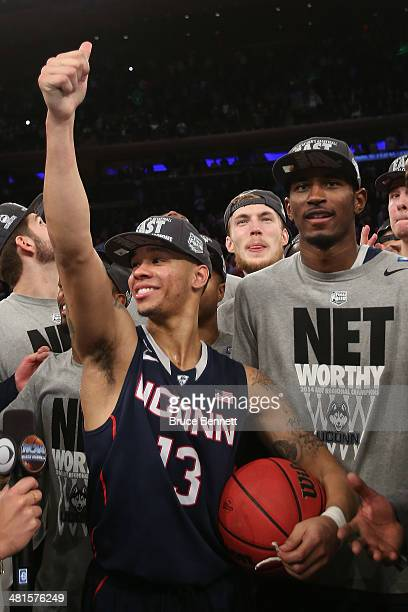 Shabazz Napier of the Connecticut Huskies celebrates after defeating the Michigan State Spartans to win the East Regional Final of the 2014 NCAA...