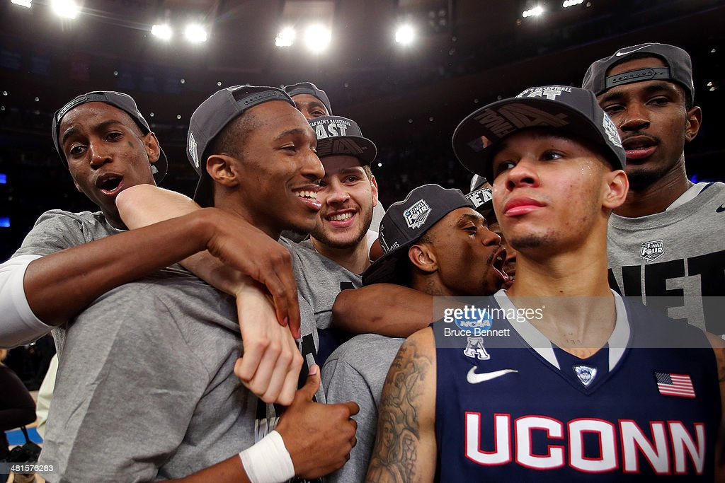 Shabazz Napier #13 of the Connecticut Huskies celebrates after defeating the Michigan State Spartans to win the East Regional Final of the 2014 NCAA Men's Basketball Tournament at Madison Square Garden on March 30, 2014 in New York City.