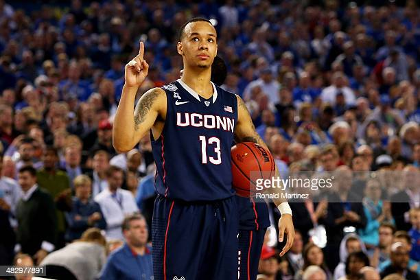 Shabazz Napier of the Connecticut Huskies celebrates during the NCAA Men's Final Four Semifinal against the Florida Gators at ATT Stadium on April 5...