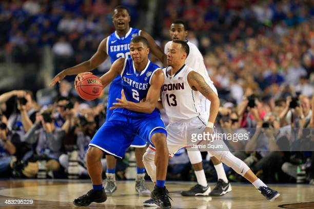 Shabazz Napier of the Connecticut Huskies defends against Aaron Harrison of the Kentucky Wildcats during the NCAA Men's Final Four Championship at...