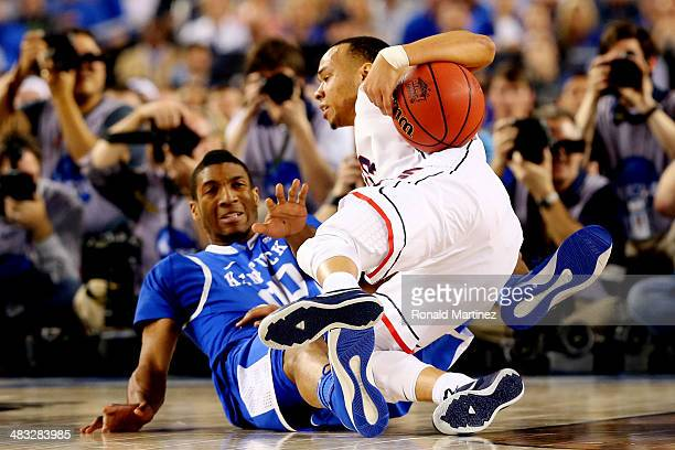 Shabazz Napier of the Connecticut Huskies falls to the ground as Marcus Lee of the Kentucky Wildcats defends during the NCAA Men's Final Four...
