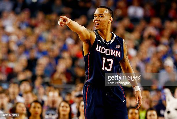 Shabazz Napier of the Connecticut Huskies gestures during the NCAA Men's Final Four Semifinal against the Florida Gators at ATT Stadium on April 5...