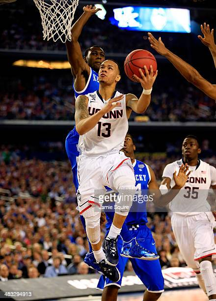 Shabazz Napier of the Connecticut Huskies goes to the basket against the Kentucky Wildcats defends during the NCAA Men's Final Four Championship at...