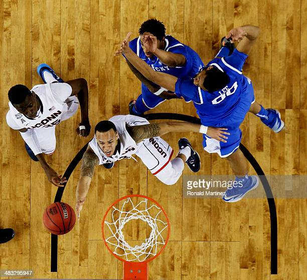 Shabazz Napier of the Connecticut Huskies goes up for a shot as Marcus Lee of the Kentucky Wildcats defends during the NCAA Men's Final Four...