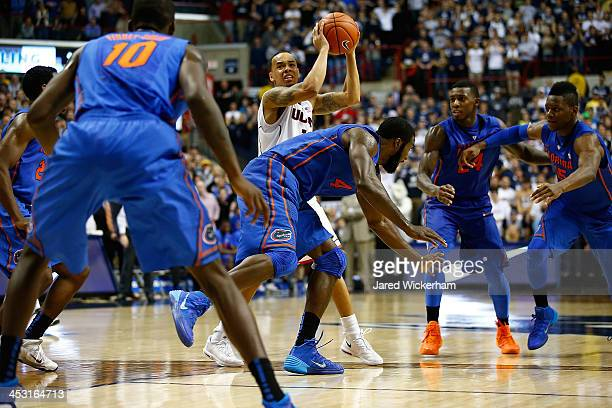 Shabazz Napier of the Connecticut Huskies grabs the loose ball before making his last second shot against the Florida Gators during the game at Harry...