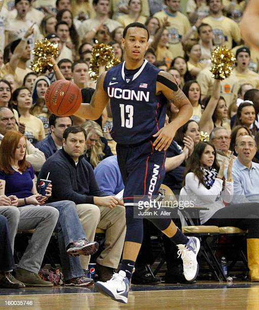 Shabazz Napier of the Connecticut Huskies handles the ball against the Pittsburgh Panthers at Petersen Events Center on January 19, 2013 in...